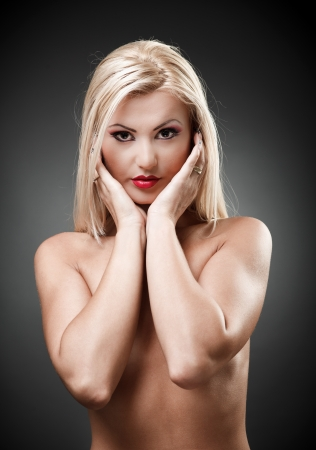 Studio shot of a beautiful topless blond woman on gray background, closeup Stock Photo - 16324255