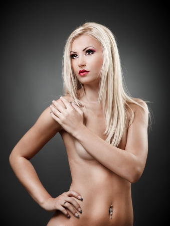 nice breast: Portrait of a topless blond woman holding hand on shoulder Stock Photo