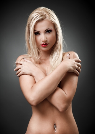 Portrait of a topless blond woman with crossed arms Stock Photo - 16324253