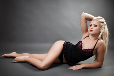 Full length portrait of a beautiful woman wearing lingerie while laying on the floor Stock Photo - 16324199