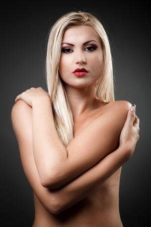 Portrait of a beautiful topless woman covering her breasts with her arms Stock Photo - 16324259