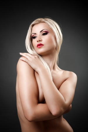 Portrait of a beautiful topless woman covering her breasts with her arms Stock Photo - 16324200