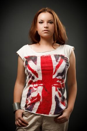Studio portrait of a beautiful redhead woman Stock Photo - 16324301