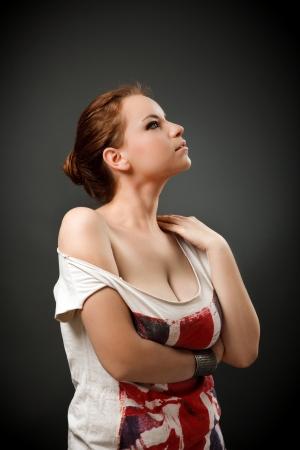 big breast: Studio portrait of a beautiful redhead woman