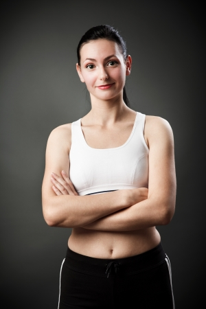 Studio portrait of a beautiful sporty woman with crossed arms Stock Photo - 16324201