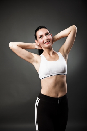 Studio portrait of a beautiful sporty woman stretching her body Stock Photo - 16324188