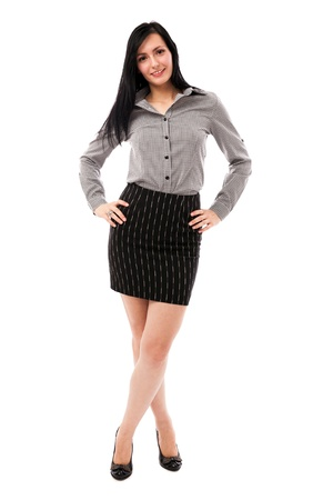 skirt suit: Full length portrait of a beautiful businesswoman standing with hands on hips isolated on white background