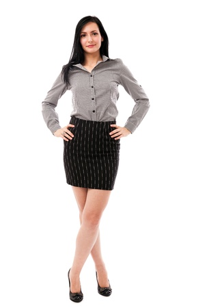 Full length portrait of a beautiful businesswoman standing with hands on hips isolated on white background photo