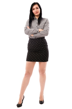 Full length portrait of a beautiful businesswoman standing with crossed arms isolated on white background Stock Photo
