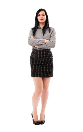 Full length portrait of a beautiful businesswoman standing with crossed arms isolated on white background photo