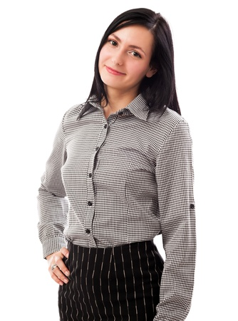 Portrait of a beautiful businesswoman standing with hand on hip isolated on white background