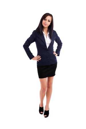 arms akimbo: Full length portrait of a beautiful latin businesswoman standing with hands on hips isolated on white background Stock Photo