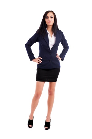 Full length portrait of a beautiful latin businesswoman standing with hands on hips isolated on white background photo