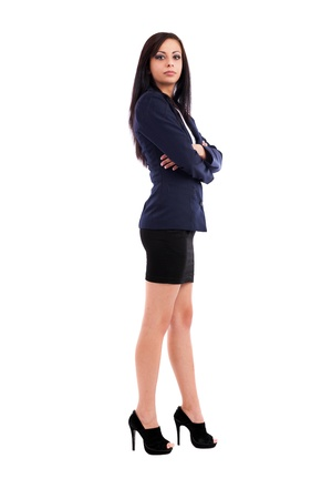 Full length portrait of a beautiful latin businesswoman standing with crossed arms isolated on white background photo