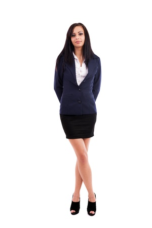 Full length portrait of a beautiful latin businesswoman standing with crossed legs isolated on white background photo