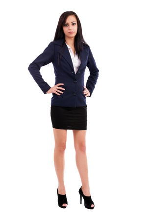 Full length portrait of a beautiful latin businesswoman standing with hands on hips isolated on white background Stock Photo