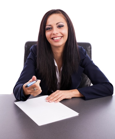 Closeup portrait of a beautiful latin businesswoman writing while sitting at desk isolated on white background photo