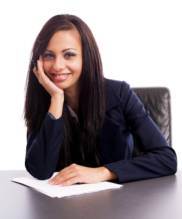 Closeup portrait of a latin businesswoman thinking while sitting at desk isolated on white background Stock Photo - 16324159