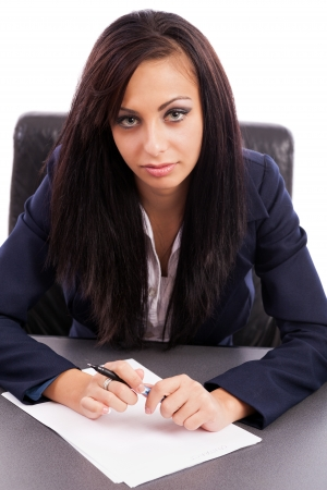 Portrait of a hispanic businesswoman writing while sitting at desk Stock Photo - 16324249