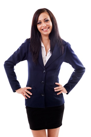 arms akimbo: Portrait of a latin businesswoman standing with hand on hips isolated on white background