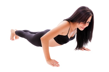 Full length portrait of a hispanic woman doing pushups isolated on white background photo