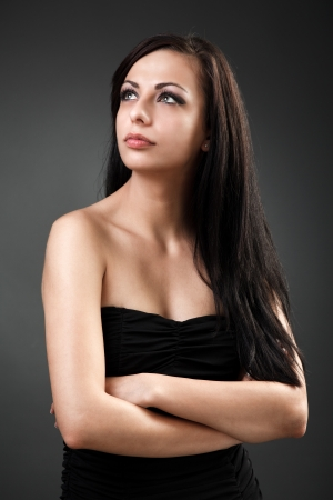 Closeup portrait of a beautiful hispanic woman standing with crossed arms Stock Photo - 16324270