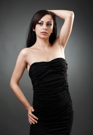 Portrait of a beautiful latin woman standing with hand on hip Stock Photo - 16324260