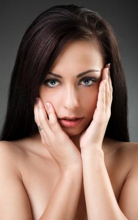 Closeup portrait of a beautiful latin woman Stock Photo - 16324251