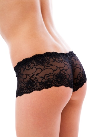 Closeup of a sexy woman's ass wearing black lingerie isolated on white background Stock Photo - 16519515