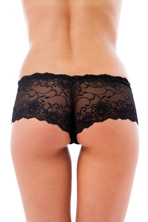 Closeup of a sexy woman's ass wearing black lingerie isolated on white background Stock Photo - 16519518