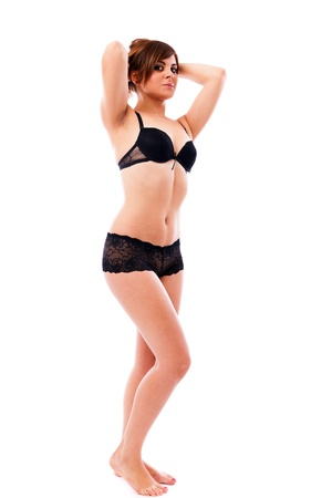 Full length portrait of a sexy woman wearing black lingerie isolated on white background Stock Photo - 16519585