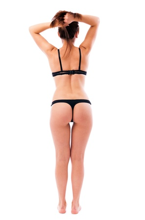 Full length portrait of a sexy woman wearing black lingerie isolated on white background Stock Photo - 16519586