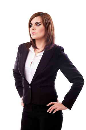 Portrait of a businesswoman standing with hands on hips isolated on white background Stock Photo - 16519540