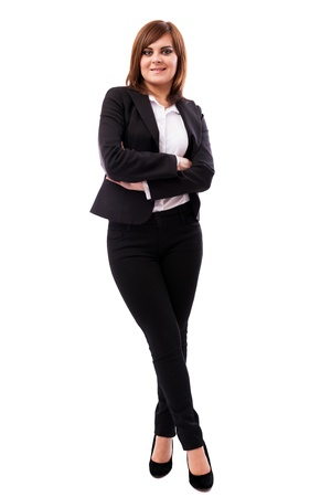Full length portrait of a beautiful businesswoman standing with crossed arms and legs isolated on white background Stock Photo - 16519584