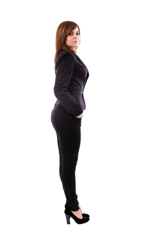 Full length portrait of a beautiful businesswoman standing with hands in pockets isolated on white background Stock Photo - 16519576