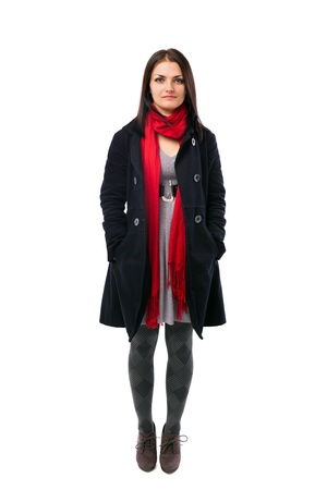 Full length portrait of a young woman wearing coat isolated on white background photo