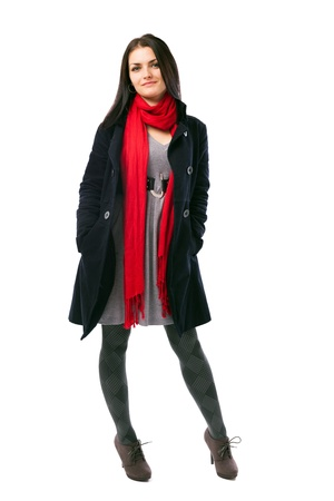 Full length portrait of a young woman wearing coat isolated on white background Stock Photo - 16519527