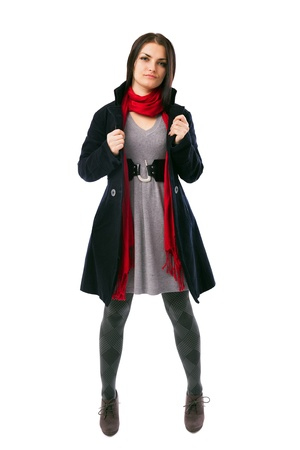 Full length portrait of a young woman wearing coat isolated on white background Stock Photo - 16519579