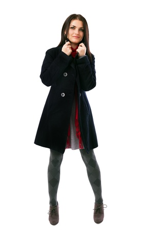 Full length portrait of a young woman wearing coat isolated on white background Stock Photo - 16519564