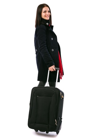 Full length portrait of a young woman holding a luggage isolated on white background Stock Photo - 16519578