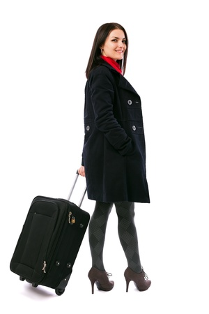 Full length portrait of a young woman holding a luggage isolated on white background Stock Photo - 16519580