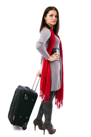 Full length portrait of a young traveler woman holding a luggage isolated on white background Stock Photo - 16519531