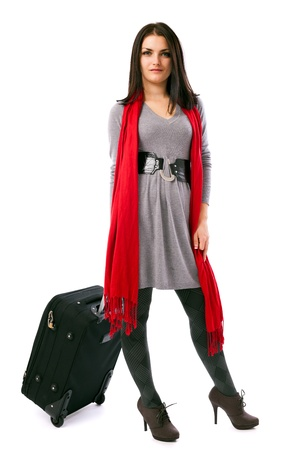 Full length portrait of a young traveler woman holding a luggage isolated on white background Stock Photo - 16519517