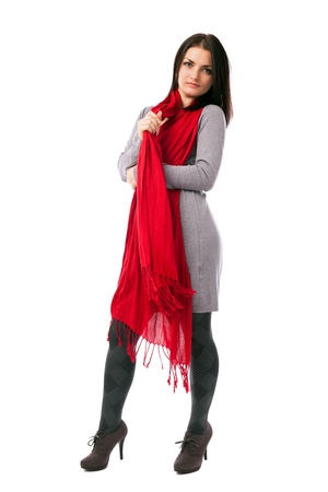 Full length portrait of a young woman posing with red scarf isolated on white background photo