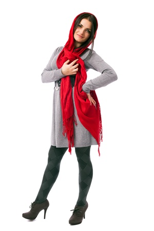 Full length portrait of a beautiful woman with long red scarf isolated on white background photo