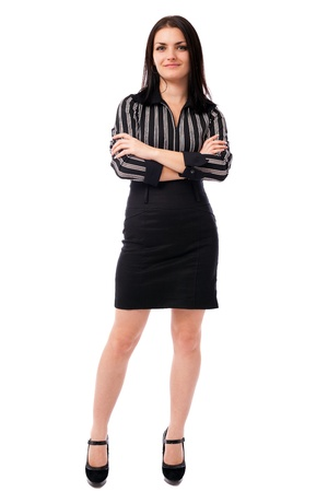 Full length portrait of a young businesswoman standing with crossed arms isolated on white background Stock Photo - 16519563