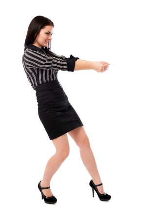 Full length portrait of a businesswoman pulling an imaginary rope isolated on white background Stock Photo - 16519560