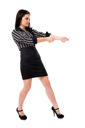 Full length portrait of a businesswoman pulling an imaginary rope isolated on white background Stock Photo - 16519562