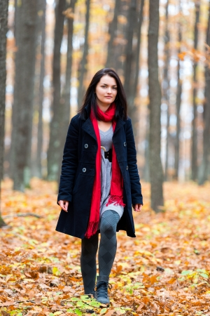 Beautiful young caucasian woman in an autumnal landscape Stock Photo - 16519470