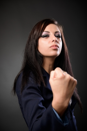 Young latin businesswoman showing her fist with a combative attitude Stock Photo - 16519523